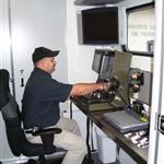 Bomb technician operating computer equipment