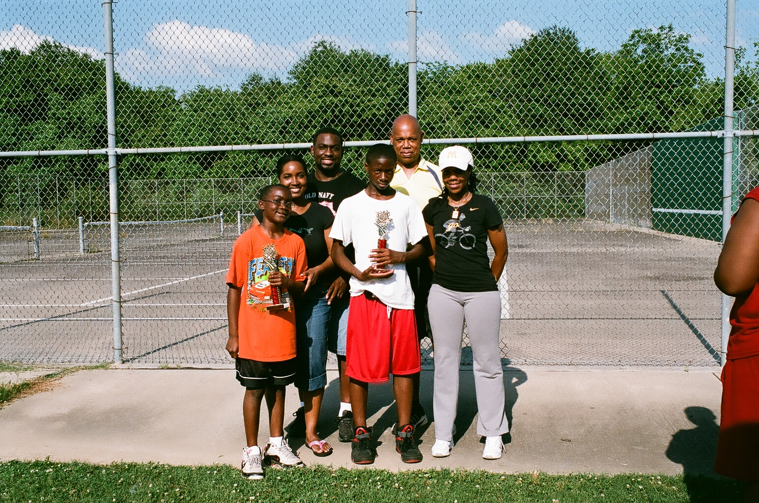 Tennis group photo with family